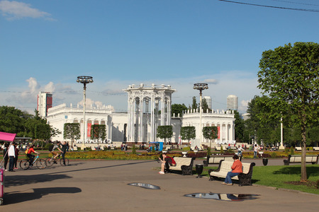 pilasters: People relaxing in the park VDNKh near the Pavilion 66
