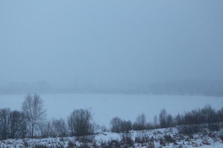 Fog over the frozen lake Stock fotó