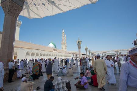 MEDINA, SAUDI ARABIA - APRIL 19, 2016 : Muslim Devotees Resting Under The Giant Retractable Tent At Prophet Muhammad Mosque In Medina