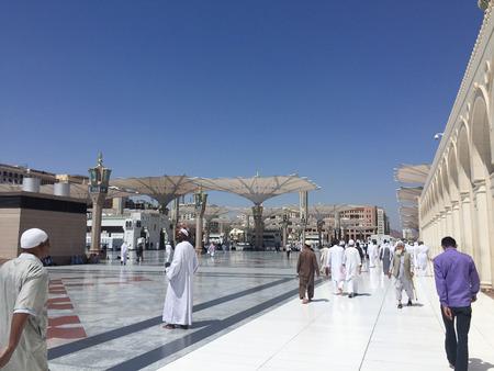 MEDINA, SAUDI ARABIA - APRIL 19, 2016 : Muslim Devotees At Prophet Muhammad Mosque In Medina