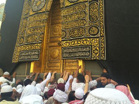 MAKKAH, SAUDI ARABIA - APRIL 22, 2016 : Muslim Devotees Trying To Touch The Golden Door Of Kaabah.