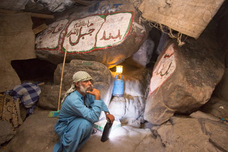 MAKKAH, SAUDI ARABIA - APRIL 28, 2016 : An Unidentified Arab Who Taking Care Of The Entrance Of Cave Of Hira. Cave Of Hira Is A Talus Cave About 3 Kilometres From Mecca, On The Mountain Named Jabal Nur In The Hejaz Region Editorial