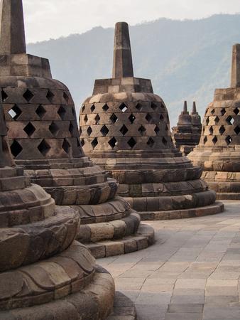 Bell-shaped stupas decorate the Borobudur temple near Yogyakarta Indonesia. Standard-Bild