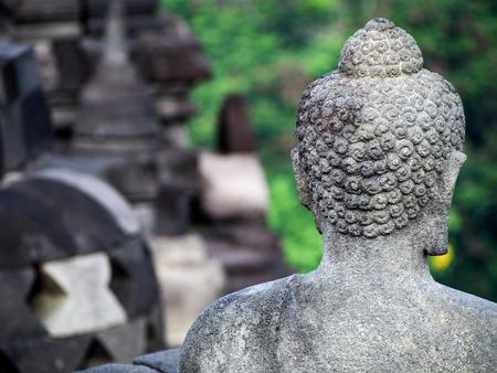 Head of a Buddha  statue in a stupa at Borobudur temple near Yogyakarta Indonesia.