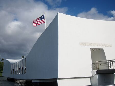 An American flag flys over the Arizona Memorial where the USS Arizona was sunk during the attack on Pearl Harbor on Oahu Hawaii.
