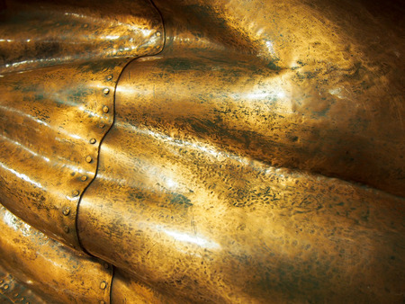 Detail of the seam of a copper statue. Banco de Imagens