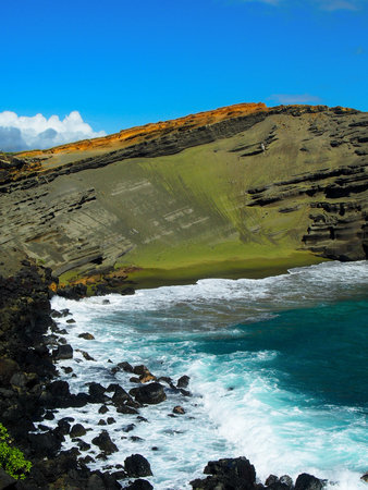 Green sand is formed naturally from volcanic rock on Hawaii's big island creating a green beach.