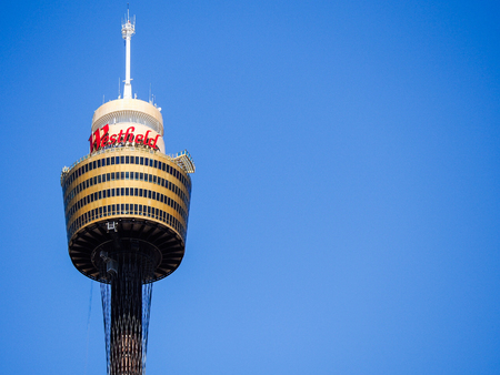 amp tower: The tallest structure in the city of Sydney Australia against a bright blue sky.