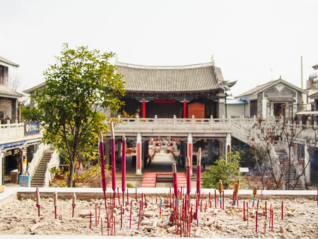 Sticks of incense burning at a temple in Dali in the Yunnan Province of China. Stock Photo