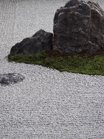 A detail shot of a rock in a zen garden in Kyoto Japan. Stock Photo