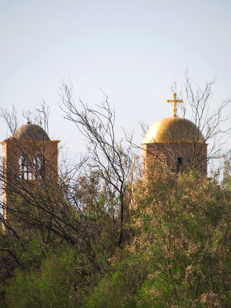 coptic orthodox: The gold dome and cross of an orthodox church at the holy site of Bethany Beyond the Jordan.