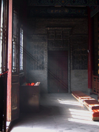 Sunlight streams into the Temple of the Eight Immortals in Xian China.