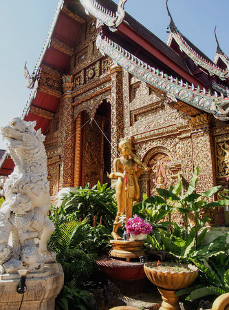 A highly decorated temple in Chiang Mai Thailand Imagens - 73749778