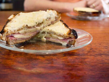 Ingredients and making of a croque monsieur French ham and cheese sandwich, toasted, meal, gruyere,  Stock Photo