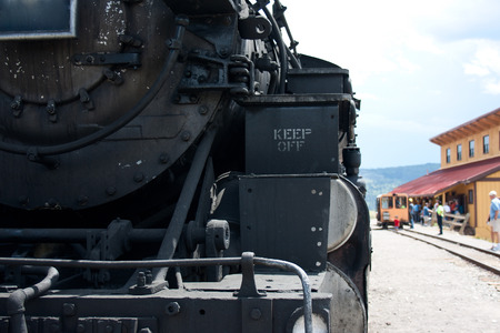 narrow gauge railroad: Detail of the front of a steam engine train in Colorado and New Mexico.