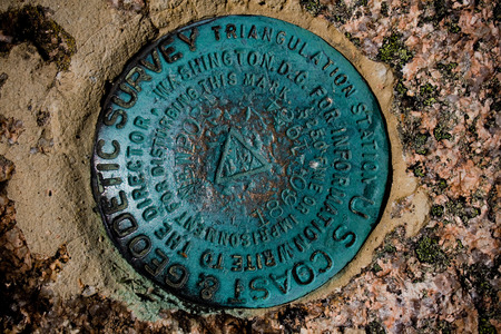 A geodetic survey marker at Acadia National Park near Bar Harbor, Maine.