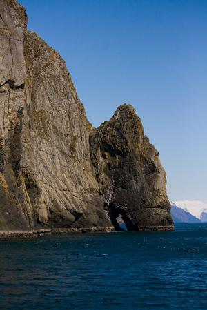 An interesting rock formation juts out of the ocean near Seward, Alaska.
