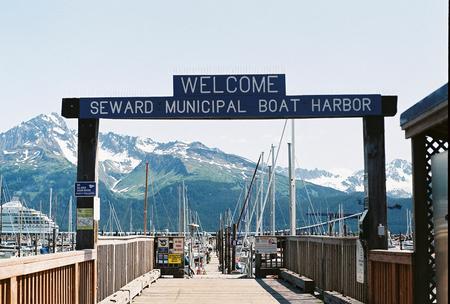 A sign marks the entrance to the Seward Municipal Boat Harbor in Seward, Alaska.