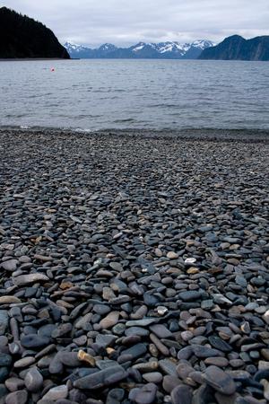 A beach made of smooth stones on Fox Island near Seward, Alaska. 写真素材