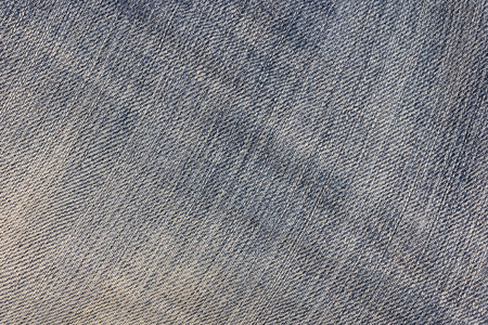 Texture of old denim surface and abstract background design classic denim. Stains on jeans