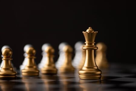 gold queen is the leader of the chess in the game on board.