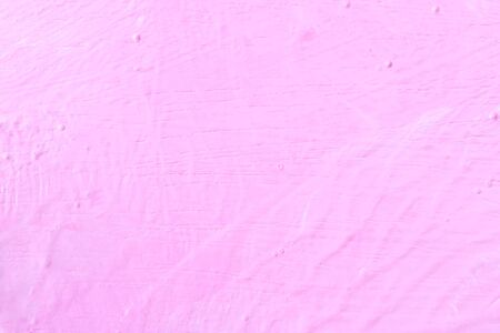 The texture of the rugged pink wall and structure background. Uneven wall paint. Фото со стока - 147815050