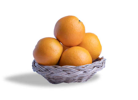 Oranges group in the wooden basket on the white background . Many types of oranges can be eaten. The fruit is sour or sweet. Often have extra calcium, potassium, vitamin A and C. 스톡 콘텐츠