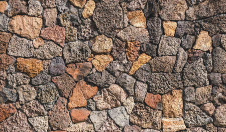 Wild stone wall texture background. High quality photo