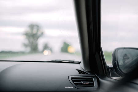 Traveling in car, exterior elements. blurred view of the road. High quality photo