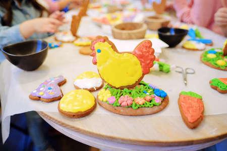 Children's hands make gingerbread. children cutting cookies. Kids baking cookies. Concept. Master class for children on baking gingerbread. High quality photo Stock Photo