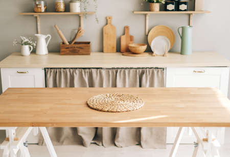 Empty wooden table in modern kitchen. High quality photo Banco de Imagens