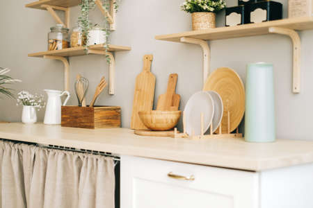 Kitchenware on the wooden table in modern bright kitchen. High quality photo Banco de Imagens