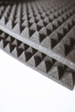 Sheets of black acoustic foam rubber isolated on white background.