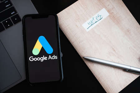 Google Ads logo on smartphone screen.