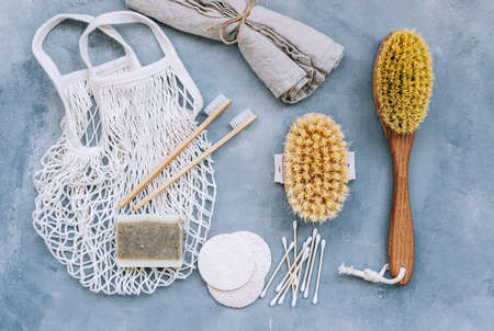 Natural eco friendly accessories for self care, dry massage brushes, bamboo toothbrushes, loofah facial sponges and natural soap. Stock fotó