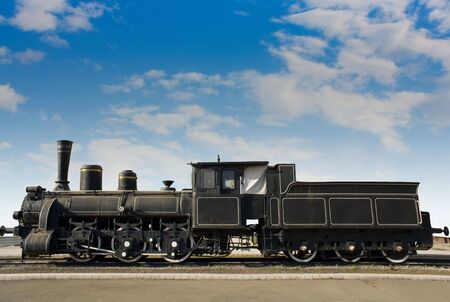 steam engine: Old rusty locomotive with the blue sky background Stock Photo