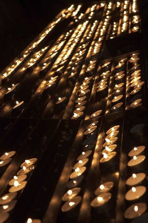 Rows of candles inside the cathedral. Stock Photo - 6772193