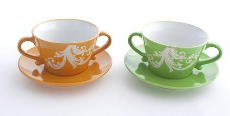 work took: Pair of orange and green ceramic  tea cups.