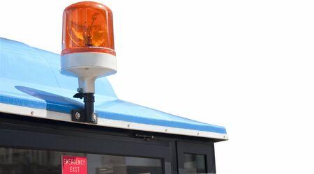 Orange light bulb above the emergency exit on the public vehicle. photo