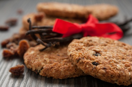 raisins: Pile of wholegrain cookies with raisins and nuts.