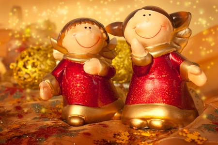 figurines: Two Christmas angels on golden setting