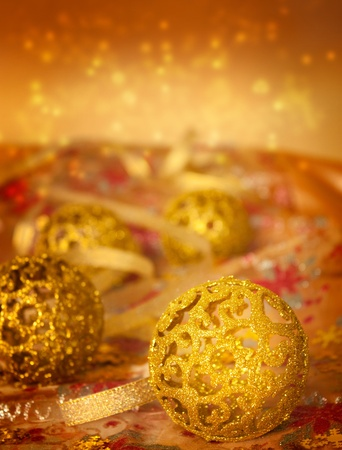Golden Christmas ornaments on glitter tablecloth. Stock Photo - 10635140
