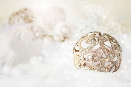 Silver rustical Christmas baubles in the snow. photo