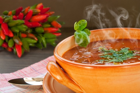 Chilli con carne with beef in a clay pot photo