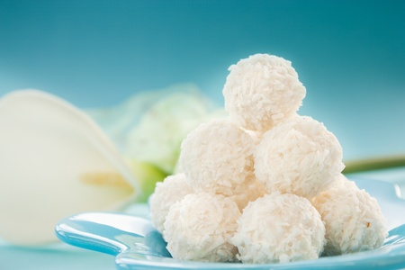 Arrangement of coconut cookies on blue background. photo