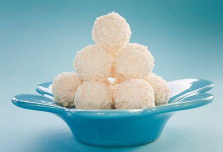 coconut sugar: Arrangement of coconut cookies on blue background.