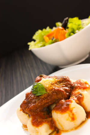 potato leaves: Beef with sauce,  gnocchi and salad.