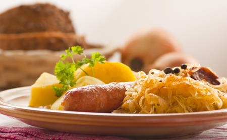 german swiss: Sausage with potatoes and sauerkraut and bread loaves
