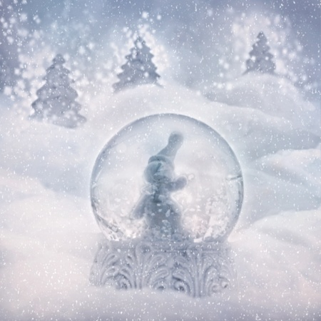 Snow globe with snowman. Winter Christmas background with snow globe photo