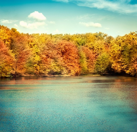 Nature landscape with beautiful lake in autumn with colorful trees and blue sky with cloudscape in the background. Stock Photo - 10682553